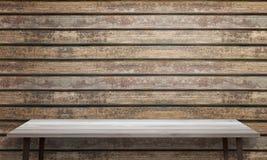 与黑腿的白色木桌 木墙壁纹理在背景中 免版税库存照片