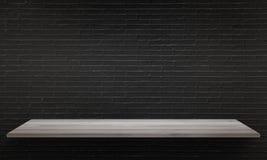 黑砖墙纹理在背景中 与自由空间的白色桌 库存图片