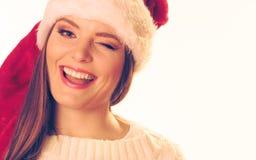 圣诞老人帽子的妇女 库存图片