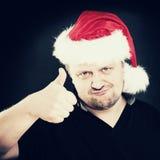 Человек рождества показывая как изолированный предпосылкой большой пец руки знака вверх по белизне Стоковые Изображения