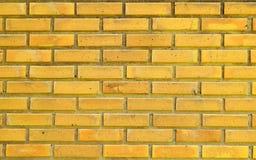 Κίτρινος τουβλότοιχος για το υπόβαθρο συστάσεων Στοκ Εικόνες