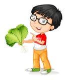 拿着新鲜蔬菜的小男孩 免版税库存照片