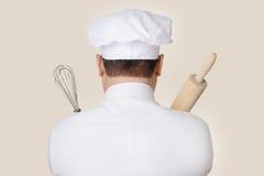 拿着烘烤工具的厨师 库存图片