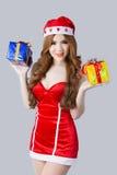 美好的亚洲妇女模型在圣诞老人衣裳 免版税库存照片