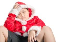 哀伤的肥胖男孩等待的圣诞节礼物 图库摄影