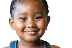 逗人喜爱的非洲女孩面孔射击被隔绝 免版税库存照片