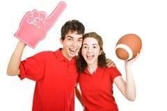 夫妇扇动青少年的橄榄球 免版税图库摄影