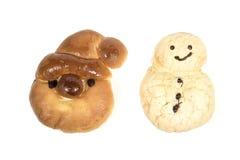 圣诞老人和雪人面包店 库存图片