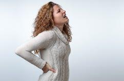 少妇以后背疼痛 免版税图库摄影