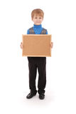 Αγόρι που κρατά έναν πίνακα φιαγμένο από φελλό Στοκ εικόνες με δικαίωμα ελεύθερης χρήσης