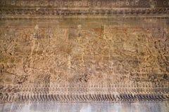 在吴哥窟寺庙,柬埔寨的古老高棉浅浮雕 免版税图库摄影