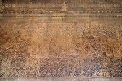在吴哥窟寺庙,柬埔寨的古老高棉浅浮雕 图库摄影