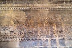 在吴哥窟寺庙,柬埔寨的古老高棉浅浮雕 免版税库存照片
