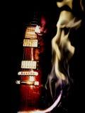 两次曝光电吉他和火 库存照片