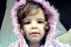 小女孩画象戴头巾外套的 免版税库存图片