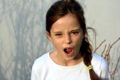 恼怒的女孩少年 免版税库存照片