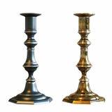 在白色背景隔绝的两个铜烛台 库存照片