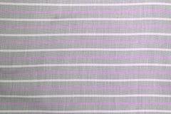 织品与条纹图形的纺织品背景 库存照片