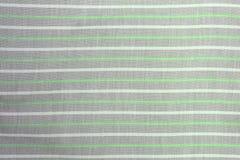 织品与条纹图形的纺织品背景 库存图片