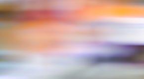 Το πολύχρωμο ελαφρύ αφηρημένο υπόβαθρο θαμπάδων κινήσεων, η θαμπάδα Στοκ Εικόνες