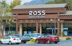 较少商店外部的罗斯礼服 免版税库存图片