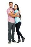 拥抱和看照相机的微笑的夫妇 免版税库存照片