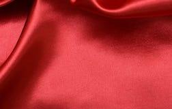红色发光的丝绸背景织品 免版税库存照片