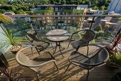 在阳台的表和椅子 免版税图库摄影