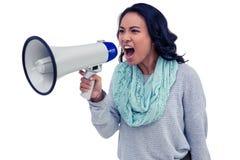 呼喊通过扩音机的亚裔妇女 免版税库存照片
