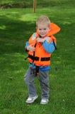 有救生衣的男孩 库存照片