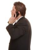 迷茫的人谈话在手机智能手机 图库摄影