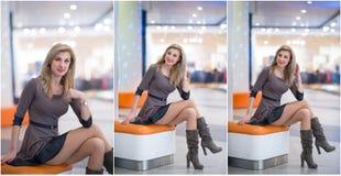 有短的摆在购物中心的礼服和长的皮靴的可爱的妇女 美丽的时兴的女孩坐橙色长凳 库存照片