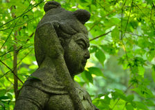 佛教监护人,京都日本石雕象  库存照片