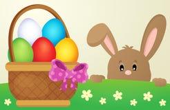 潜伏的复活节兔子和蛋篮子 免版税库存图片
