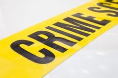 在白色背景隔绝的犯罪现场磁带 免版税库存图片
