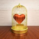 在一只金黄笼子附寄的心脏 免版税库存照片