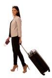 带着继续商务旅行的手提箱的妇女 免版税库存图片