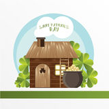 卡片为圣帕特里克天 妖精房子和罐有金黄硬币的 动画片滑稽的样式 图库摄影