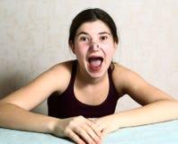 游泳者画象的女孩关闭在鼻子夹子 图库摄影