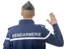 法国警察,后面看法,在白色背景 免版税库存图片