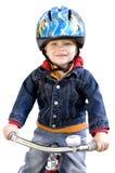 男孩骑马三轮车 库存照片