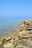 在爱奥尼亚海海岸的岩石  库存图片