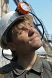 在白色的年轻矿工帽 免版税库存图片