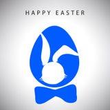 导航垂悬与弓的复活节蓝色兔子绅士鸡蛋和剪影卡片  免版税库存照片
