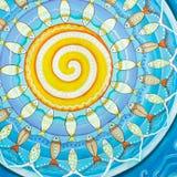 鱼和太阳,半水栖的坛场绘画 库存照片