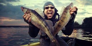 Счастливый рыболов Стоковая Фотография