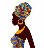 非洲女孩剪影明亮的色的头巾的 免版税库存照片