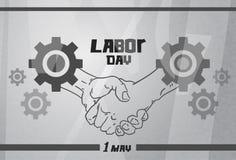 国际劳动节,握手工作者协议概念钝齿轮背景 免版税库存图片