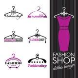 塑造商店商标-紫罗兰色晒衣架传染媒介布景 免版税库存照片