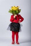 瓢虫服装的小滑稽的女孩 免版税库存照片